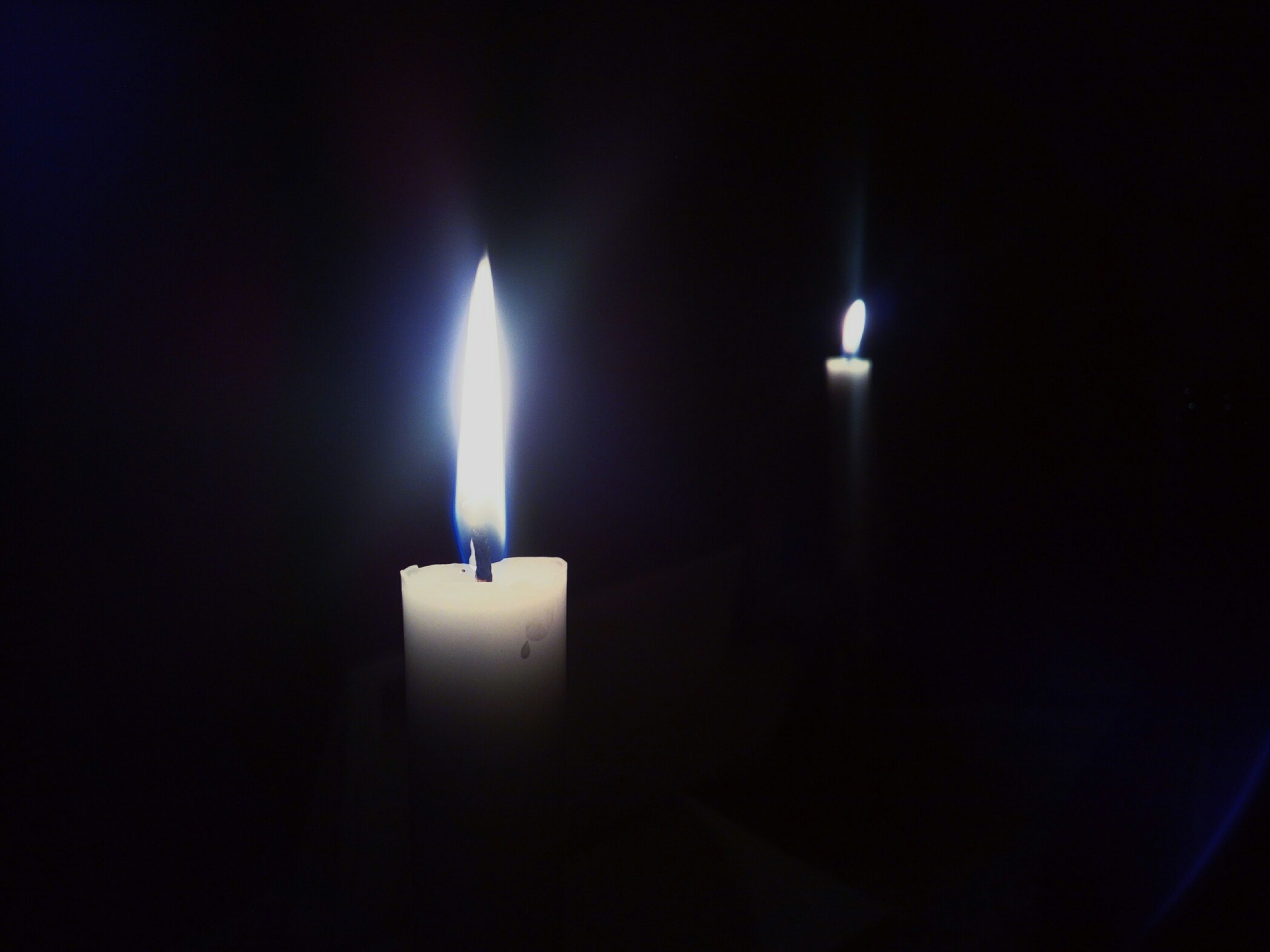 illuminated, glowing, burning, indoors, flame, candle, lit, lighting equipment, darkroom, night, dark, heat - temperature, light - natural phenomenon, fire - natural phenomenon, candlelight, electricity, black background, close-up, copy space, studio shot