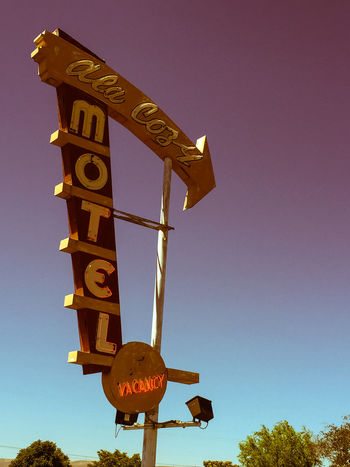 Clear Sky Illuminated Low Angle View Motel Motel Sign Neon Sign Old School Roadtrip Travel Photography Traveling Feel The Journey