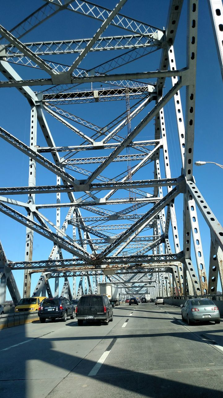 transportation, day, architecture, blue, built structure, metal, outdoors, car, clear sky, bridge - man made structure, sky, no people, low angle view, city