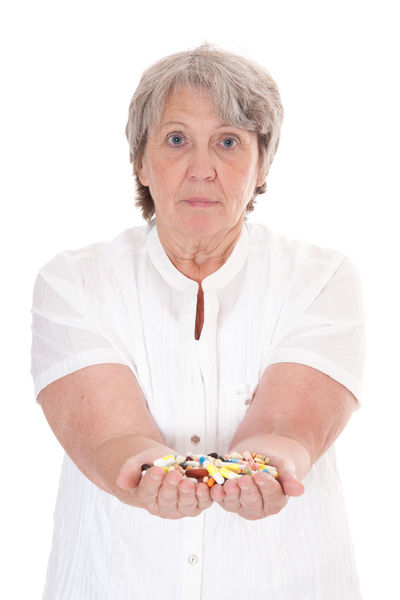 Old age woman with hands full of pharmaceuticals Drugs Grandmother Granny Health Health Supplement Isolated On White Medical Treatment Medication Old Age People Old Woman Pharmaceutical Industry Pharmaceuticals  Pills Portrait Portrait Of A Woman Retirement Retirement Home Senior Senior Adult Senior Portrait Studio Shot White Background