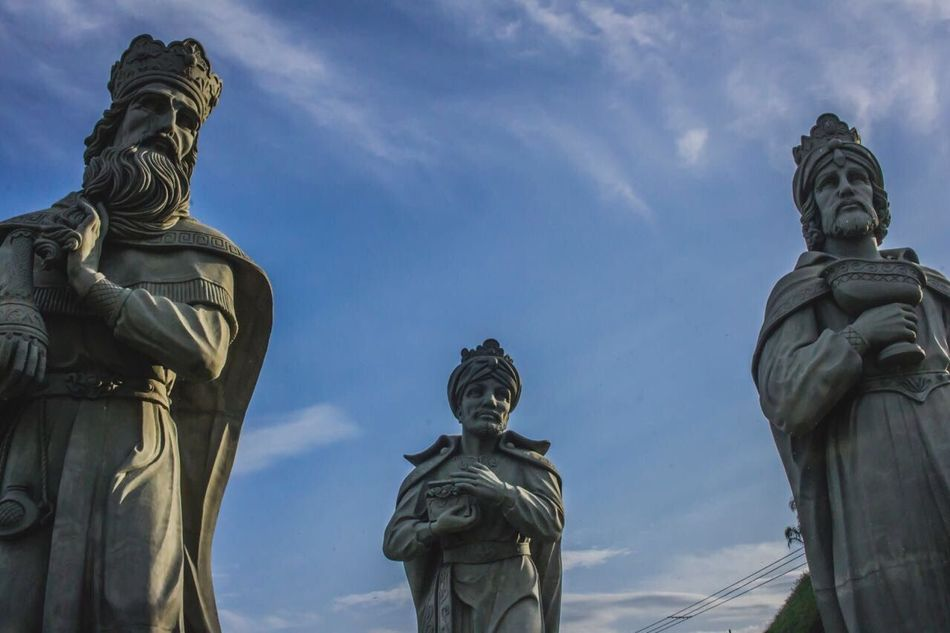 Statue Sculpture Human Representation Male Likeness Art And Craft Female Likeness Creativity Low Angle View Cloud - Sky Sky No People Day Outdoors History Built Structure Travel Destinations Architecture Building Exterior Shield Angra Dos Reis RJ BRASIL ☀️🇧🇷 Three Wise Men Statue EyeEm Best Shots