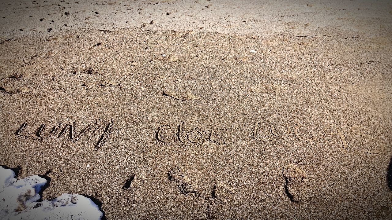 text, western script, sand, communication, beach, day, no people, outdoors, nature, close-up