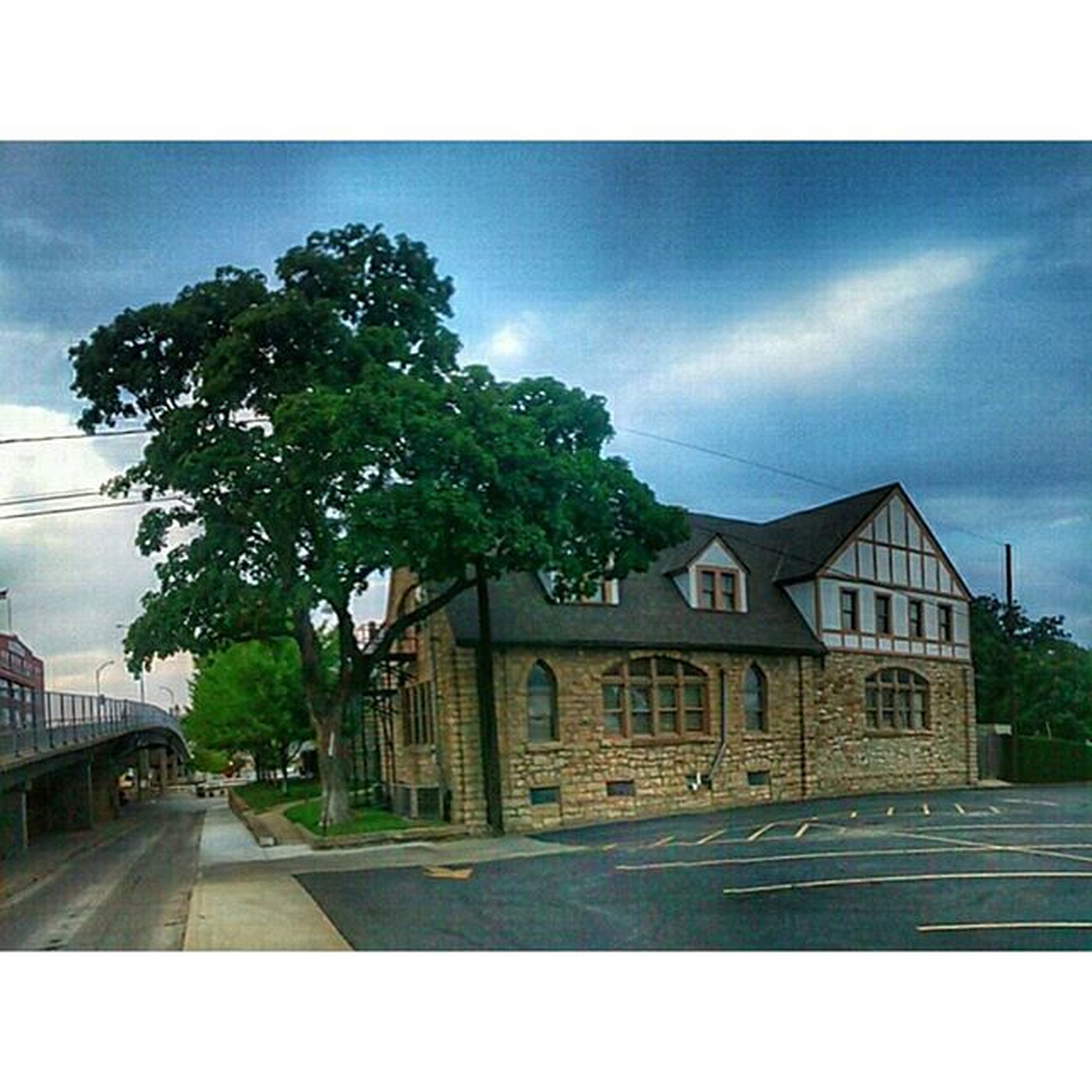architecture, building exterior, built structure, sky, transfer print, tree, the way forward, auto post production filter, cloud - sky, house, road, transportation, cloud, street, residential structure, diminishing perspective, day, residential building, outdoors, no people
