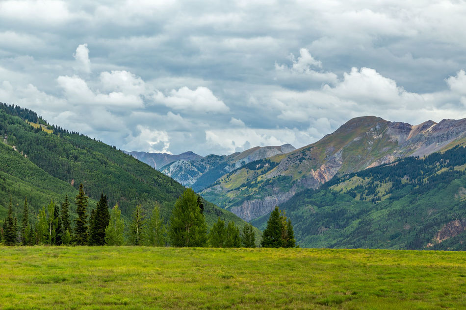 The San Juan Skyway forms a 233 mile loop in southwest Colorado traversing the heart of the San Juan Mountains festuring breathtaking mountain views and includes the portion of US 550 between Silverton and Ouray known as the Million Dollar Highway. Beauty In Nature Cloud - Sky Colorado Day Green Color Landscape Million Dollar Highway Mountain Mountain Range Nature No People Outdoors Pine Woodland Rockies Rocky Mountains San Juan Mountains San Juan Skyway Scenics Sky Southwest  Southwestern Usa