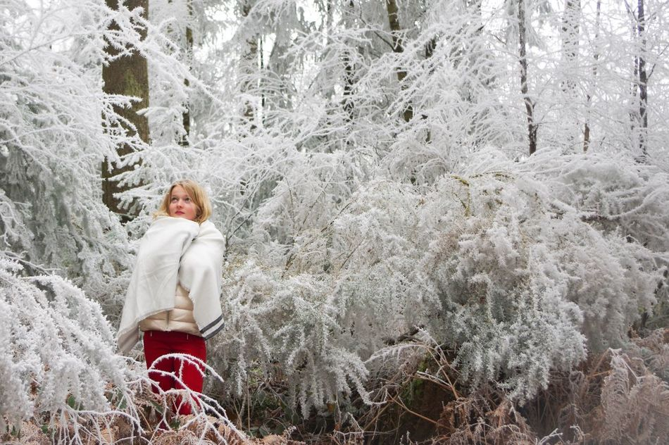Winter Is Coming Nature Cold Temperature Winter Tree One Person Lifestyles Warm Clothing Snow Outdoors Day Real People Nature People Wrapped Blond Hair Winter Forest Beauty In Nature Tree Landscape Scenics Portrait