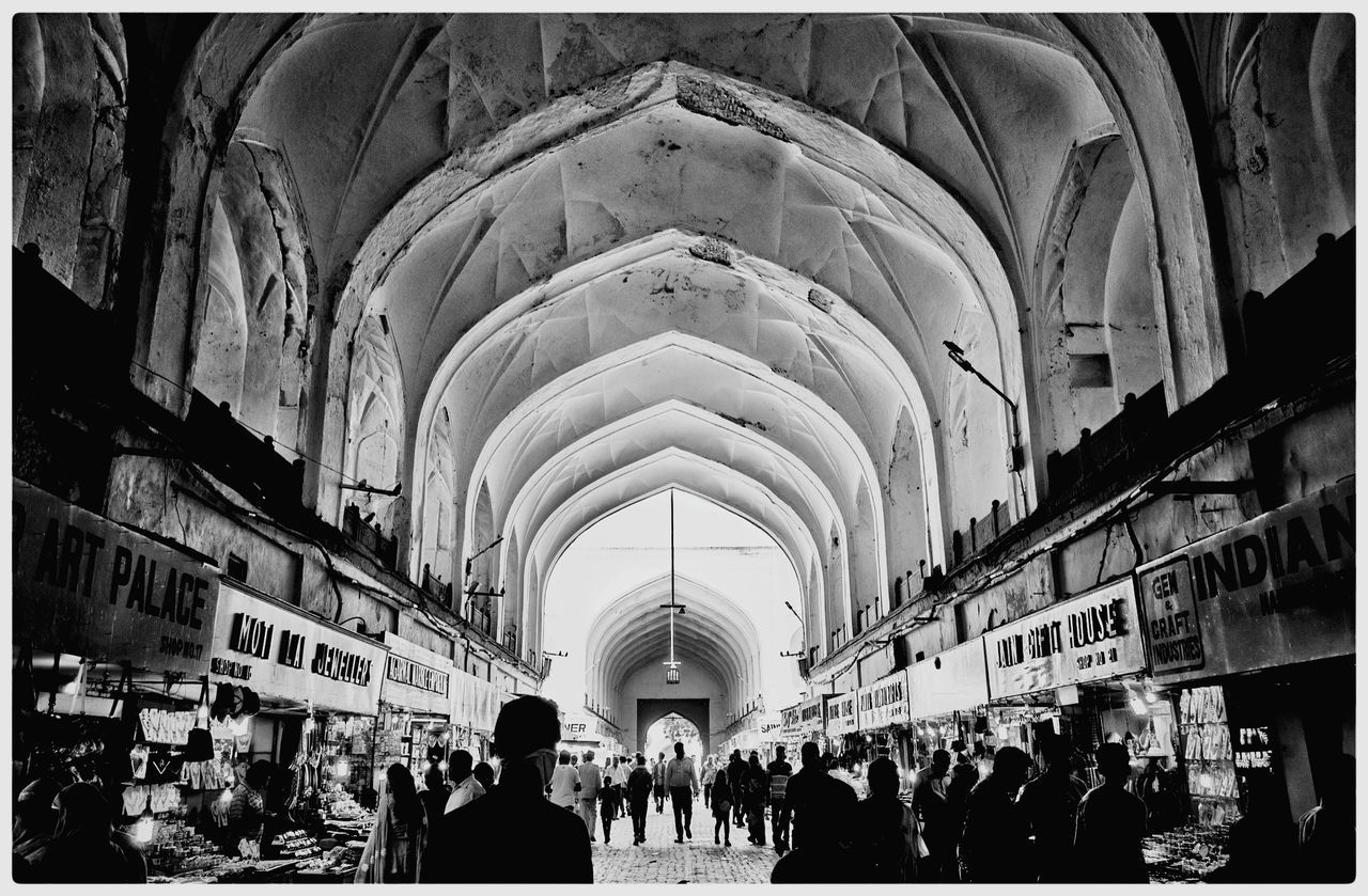 arch, large group of people, architecture, built structure, men, place of worship, religion, spirituality, real people, women, building exterior, indoors, day, crowd, people