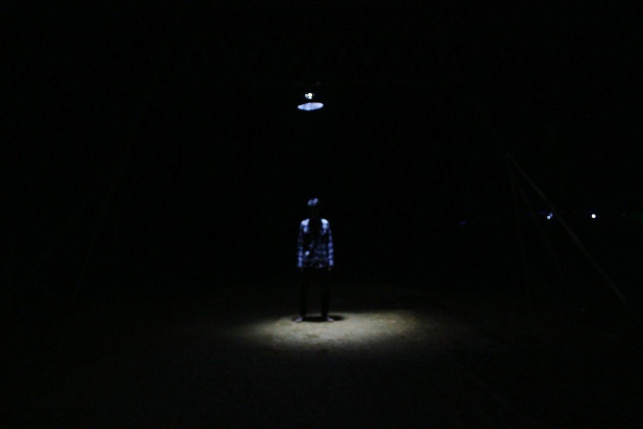 In lamp Full Length Illuminated One Person Dark Spotlight Standing People Night Futuristic Adult Photography Photo Alone EyeEm INDONESIA EyeEm Best Shots Outdoors Abstract Minimalism Black Lamp Light Light And Shadow