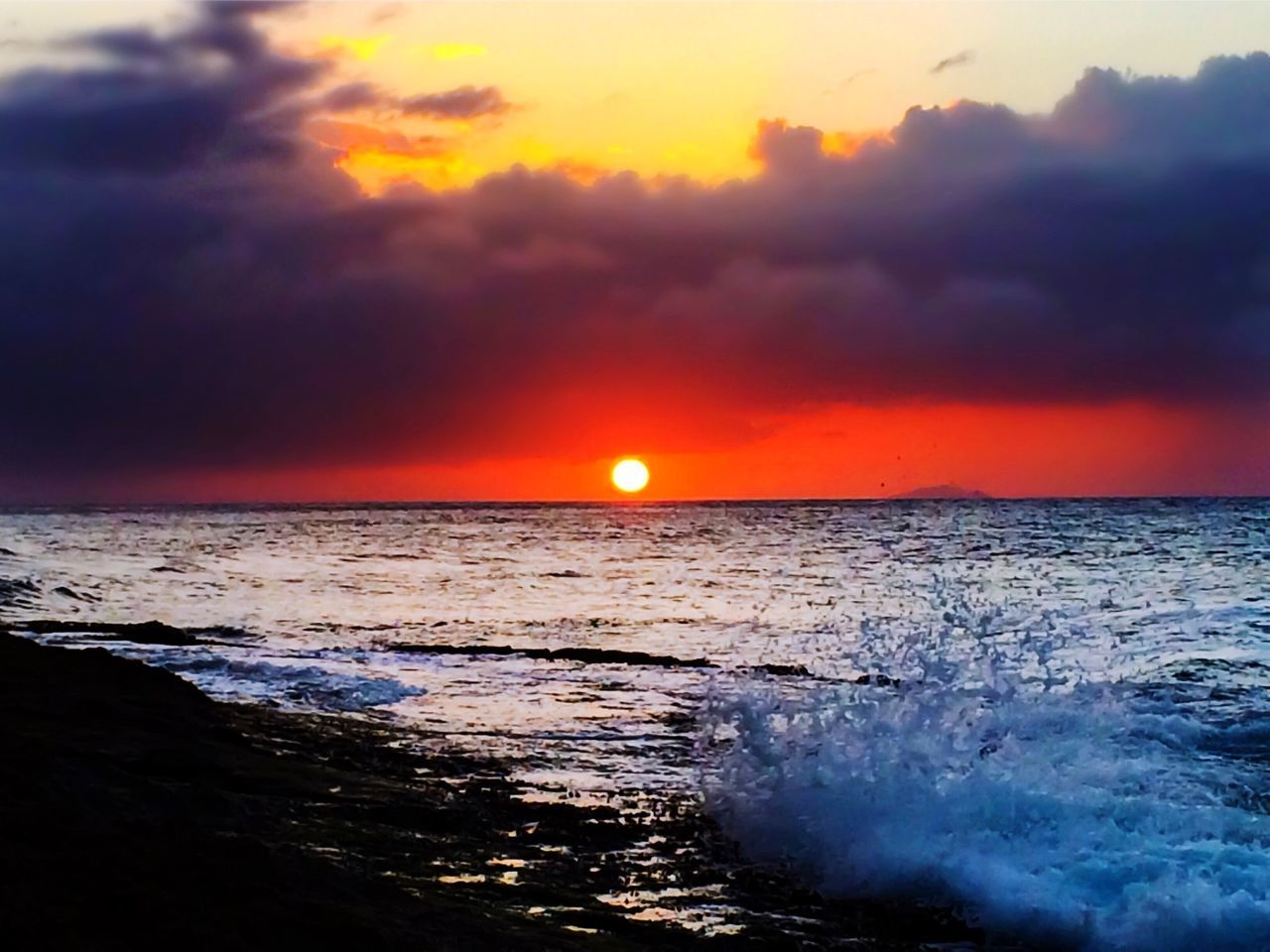 sunset, sea, beauty in nature, scenics, orange color, horizon over water, nature, sky, tranquil scene, sun, cloud - sky, tranquility, dramatic sky, water, idyllic, no people, outdoors, beach, wave, day