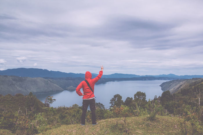 man standing on hill looking at the lake toba Field Freedom Retro Toba Tourist Travel Adventure Arms Raised Beauty In Nature Casual Clothing Cloud - Sky Day Forest Full Length Gesturing Hand Raised Hiker Hill Lake Landscape Leisure Activity Lifestyles Meadow Men Mountain Mountain Range Nature One Person Outdoors Peace Sign - Gesture People Real People Scenics Sky Standing Summer Traveler Vintage