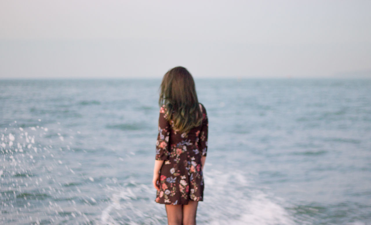 Adult Beach Beauty In Nature Day Focus On Foreground Horizon Over Water Leisure Activity Lifestyles Long Hair Nature One Person One Woman Only One Young Woman Only Only Women Outdoors People Real People Rear View Sea Sky Standing Water Women Young Adult Young Women