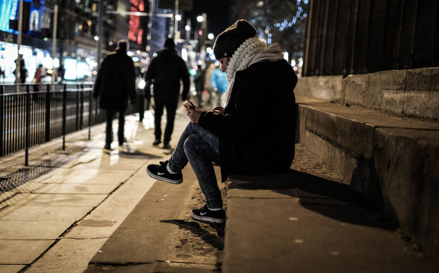 Chilling Christmas Christmas Time City Culture Deep Thought Deep Thoughts Edinburgh Edinburgh Castle Girl Mobile Night Outdoors People People And Places People Watching Phones Sitting Alone Sitting Outside Steps Street Timeout Youth Of Today