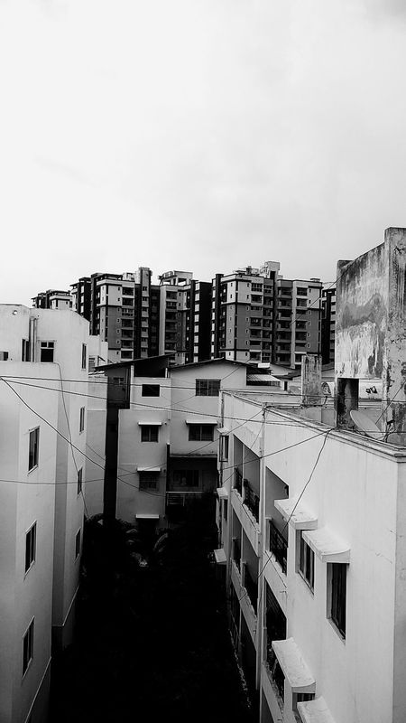 Residential Building Building Exterior Architecture Apartment Built Structure Cityscape Outdoors No People Day City Point Of View Sunset Landscape Evening Light Evening Shot Concrete Blocks Monochrome World Monochrome Concretejungle Monochromatic Playingwithshadows Concretedesign Concrete Concrete Buildings Monochrome Landscape