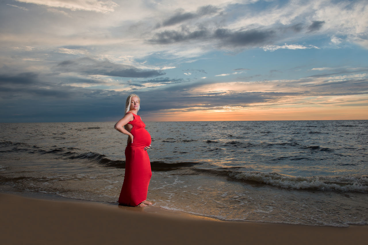 Beach Beautiful Woman Beauty In Nature Cloud - Sky Horizon Over Water Lifestyles Nature One Person People Pregnancy Pregnant Pregnant Belly  Pregnant Woman Real People Red Dress Scenics Sea Sky Standing Sunset Tranquil Scene Water Wave Young Adult Young Women