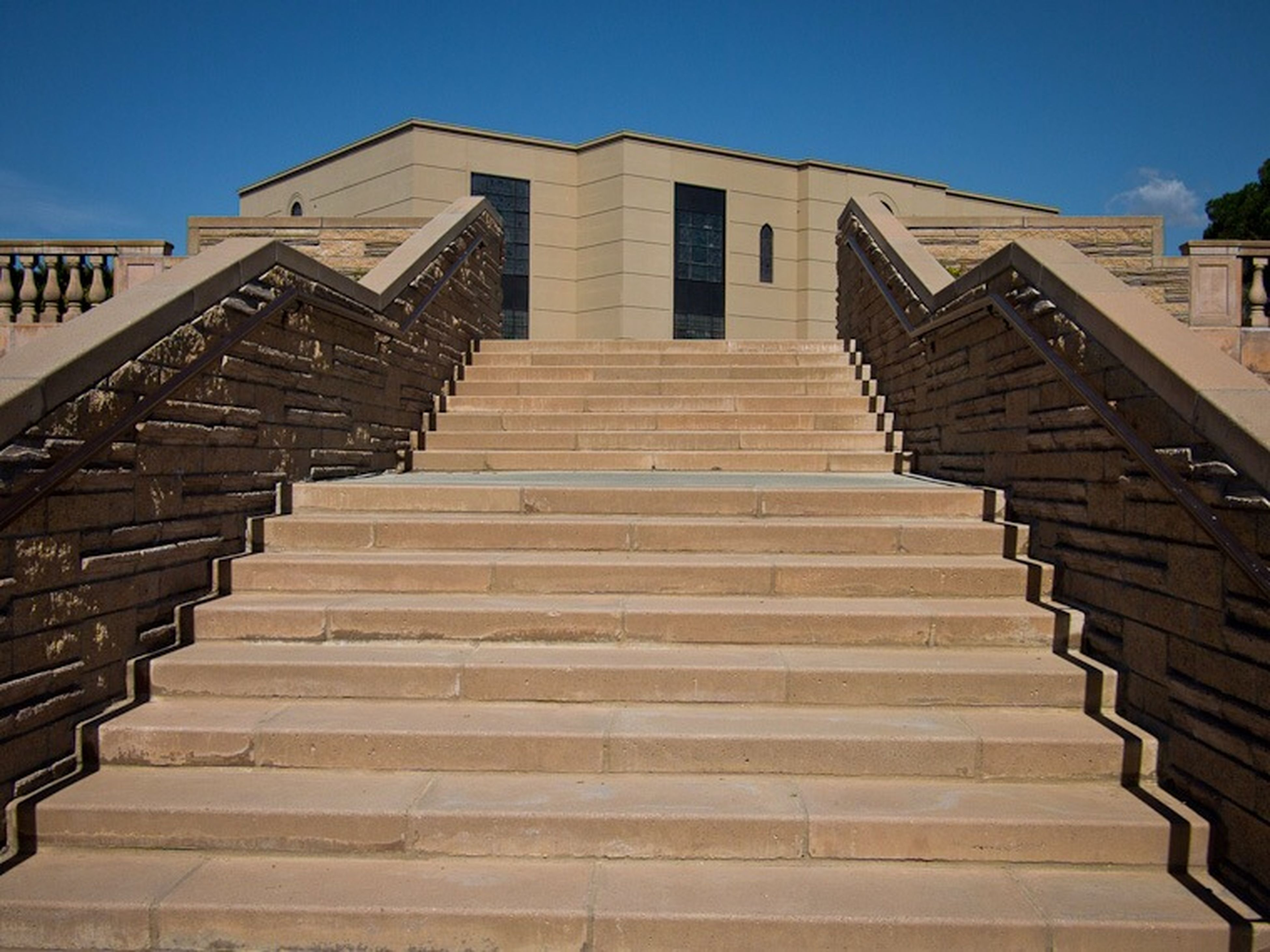 architecture, building exterior, built structure, steps, low angle view, steps and staircases, staircase, clear sky, railing, building, stairs, sunlight, sky, day, blue, residential structure, outdoors, no people, residential building, house