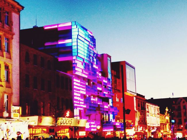 Architecture Built Structure Building Exterior Clear Sky Low Angle View City Illuminated Street Light Outdoors Blue Tall - High Office Building Modern Sky City Life Pink Color Multi Colored Building Story Vibrant Color No People Reeperbahn  Kiez Life Spielbudenplatz Bright Light Bright Colors
