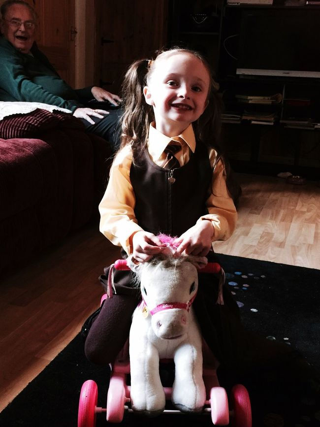 Just home after her first day in school so happy