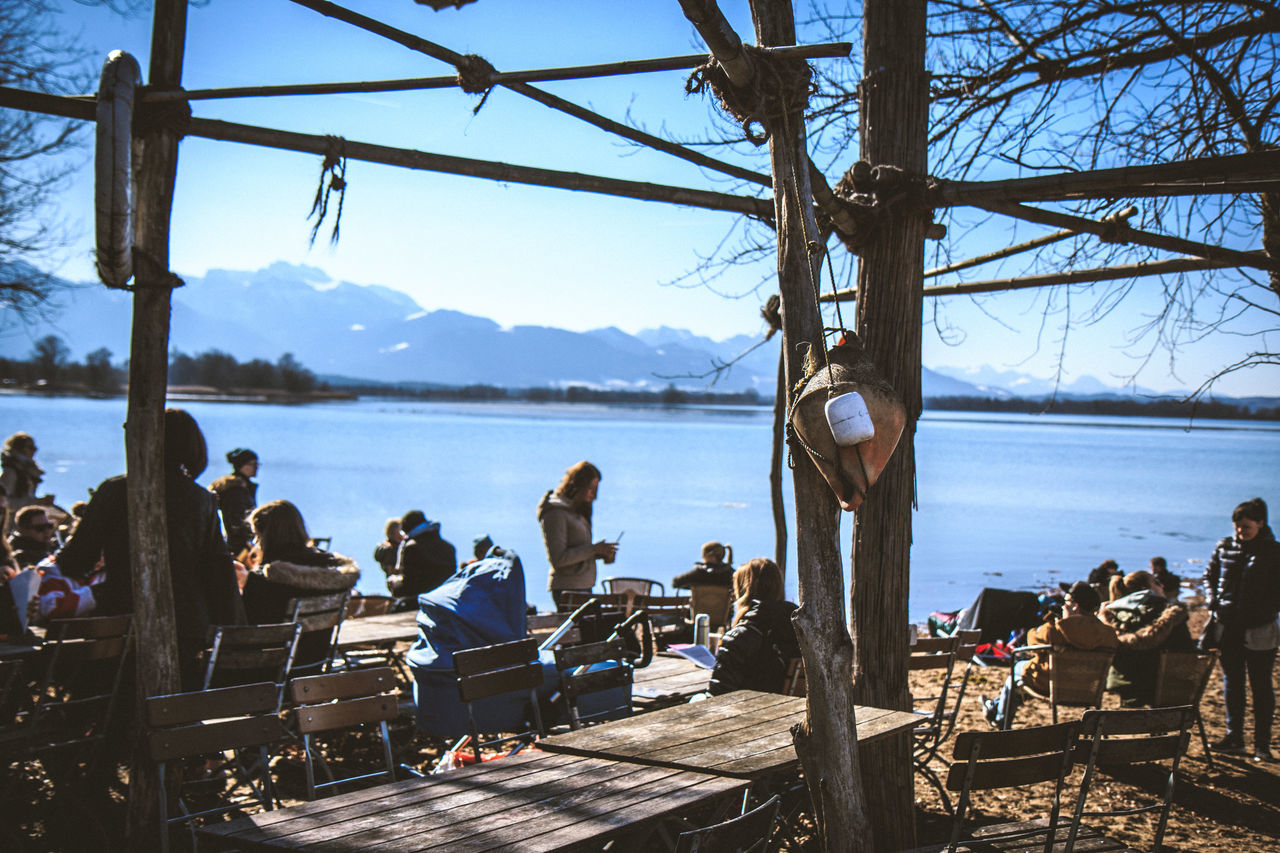 Adult Bavarian Alps Beach Life Beauty In Nature Day EyeEm Best Shots Lake Large Group Of People Men Mountain Nature Outdoors People Sitting Sky Tree Water Women