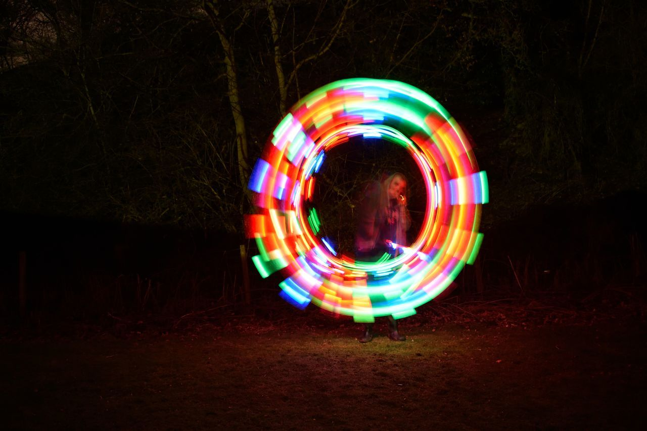 circle, light painting, night, motion, multi colored, illuminated, long exposure, light trail, blurred motion, real people, performance, skill, wire wool, outdoors, tree, one person, bubble wand, people