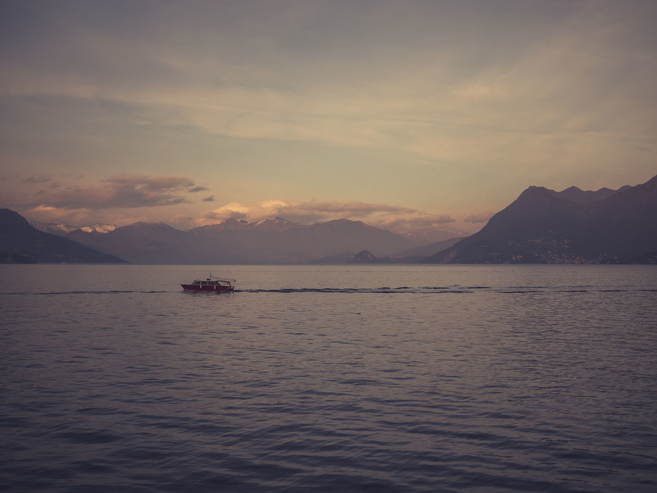 Astrology Sign Beauty In Nature Cloud - Sky Cultures Day Landscape Mountain Mountain Range Nature Nautical Vessel No People Outdoors Scenics Sky Stresa Sunset Tranquil Scene Travel Destinations Water
