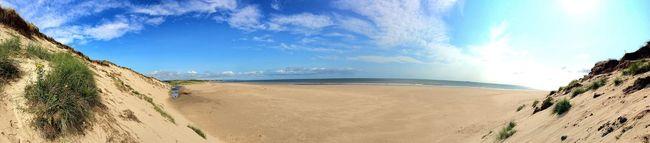Summer day on the beach Beach Crimdon