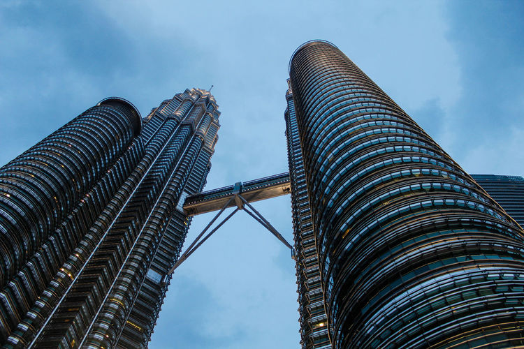 Skyscraper, from below High Rise Architecture Building Exterior Built Structure City Cloud - Sky Low Angle View Malaysia Modern Outdoors Sky Skyscraper Tall - High Travel Destinations The Week On EyeEm