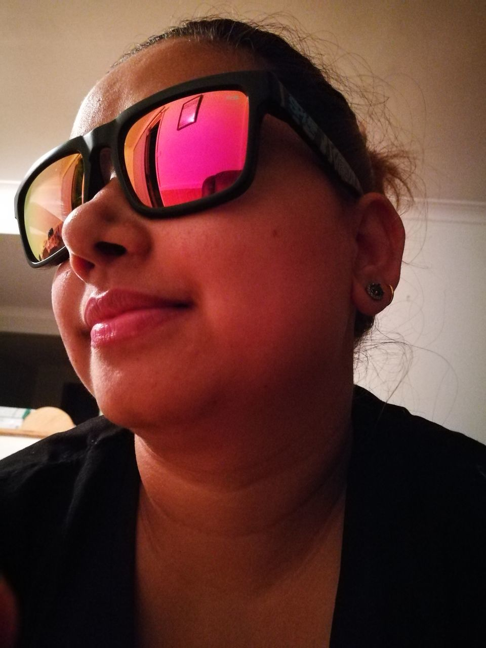Close-Up Of Woman Wearing Sunglasses At Home