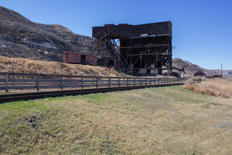 Abandoned Abandoned Buildings Abandoned Places Architecture Blue Sky Building Exterior Built Structure Clear Sky Coal Coal Mine Day Grass Landscape Mine Mining Mining History Of America Nature No People Outdoors Rural Scene Sky