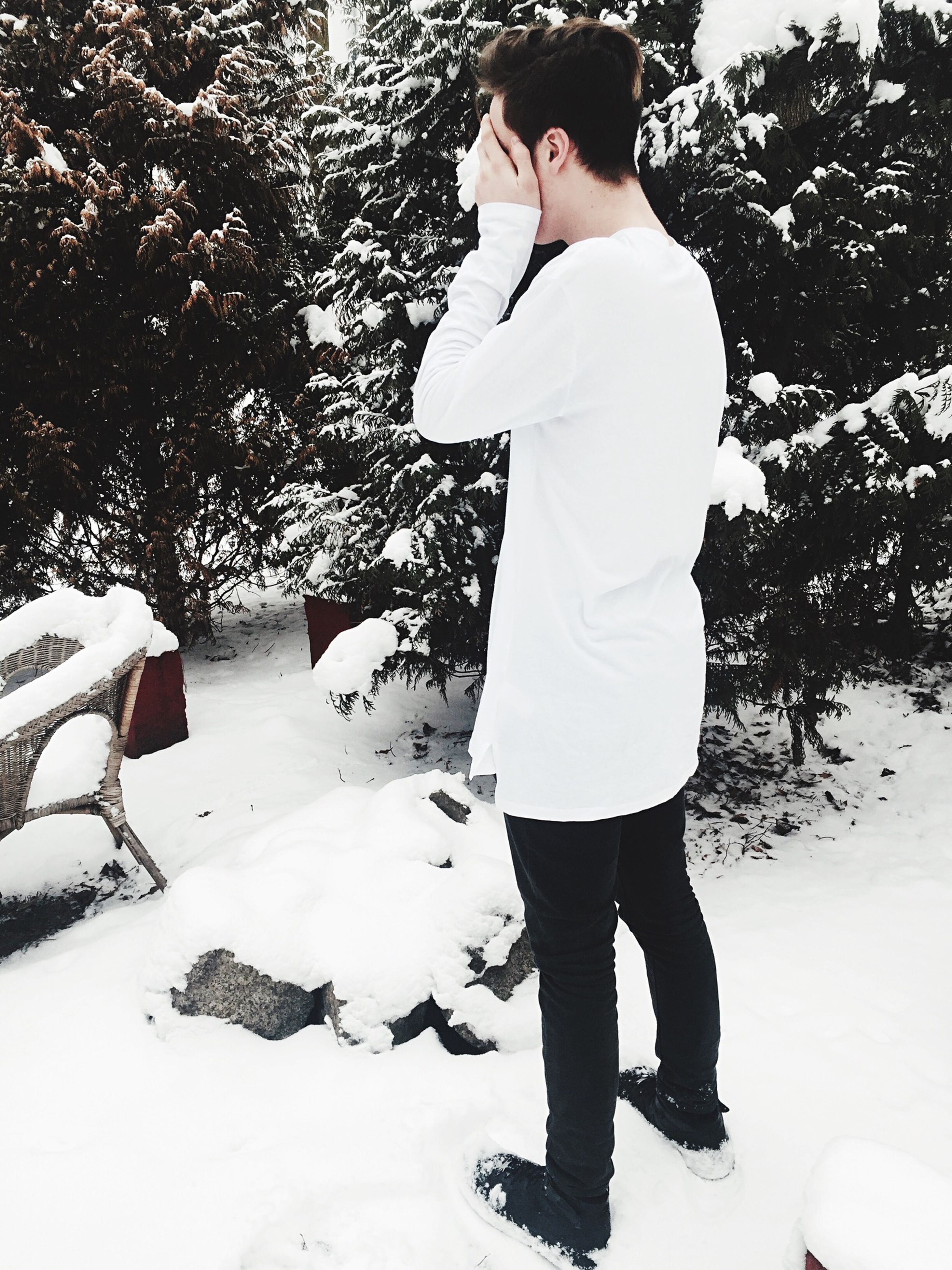 winter, snow, cold temperature, season, lifestyles, full length, standing, leisure activity, weather, casual clothing, rear view, walking, warm clothing, white color, tree, day, covering, outdoors