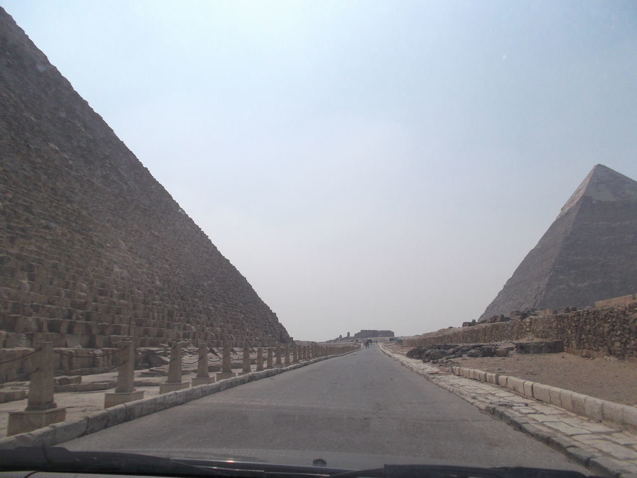road, transportation, the way forward, travel, day, car, sky, travel destinations, clear sky, no people, built structure, architecture, car point of view, outdoors, pyramid, nature
