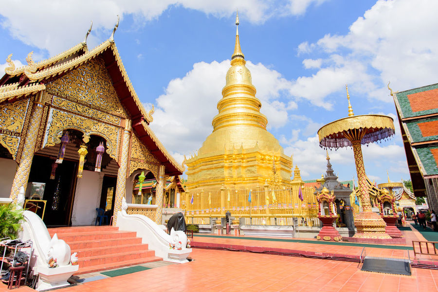 Wat Phra That Hariphunchai, temple in Lamphun, Thailand ASIA Ancient Lamphun ,Thailand Pagoda Place Of Worship Thailand Travel Architecture Buddhism Building Exterior Built Structure Day Gold Gold Colored Golden Color Golden Pagoda Outdoors Place Of Worship Real People Religion Sky Spirituality Temple Travel Destinations