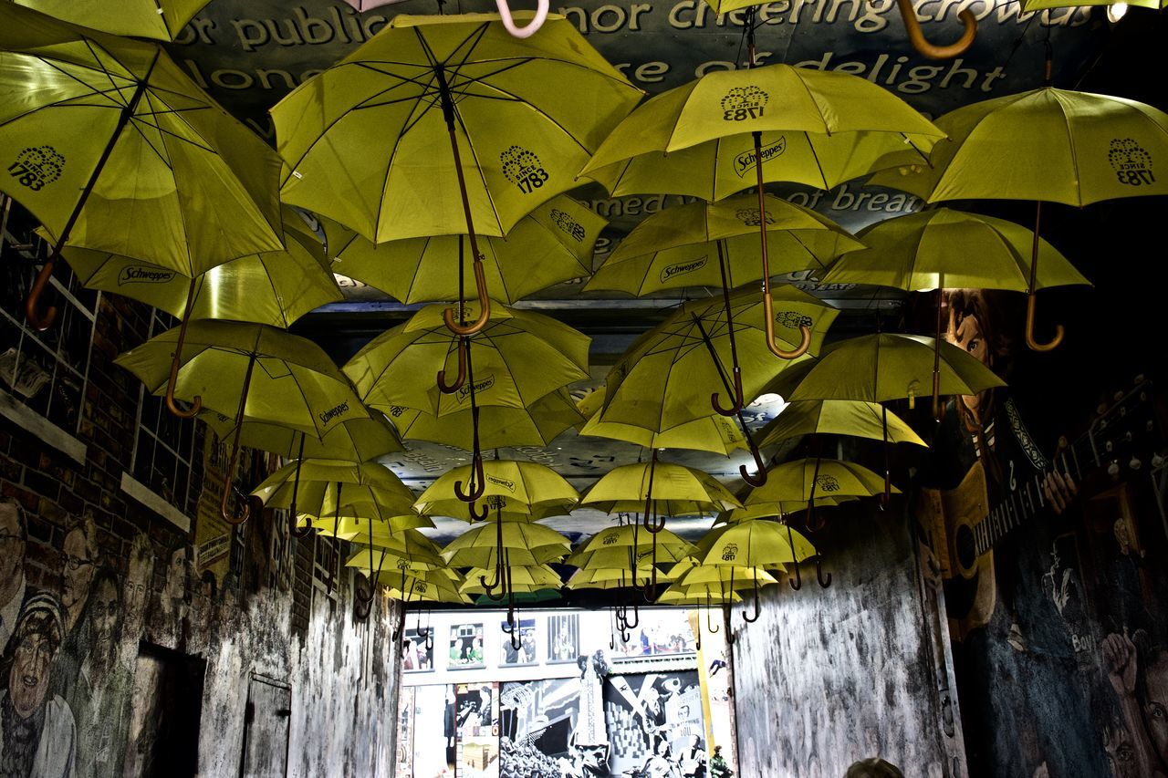 Architecture Day Graffiti Hanging Low Angle View Morden Art Nikon Nikonphotography No People Outdoors Protection Shelter Streetphotography Umbrella Under Yellow
