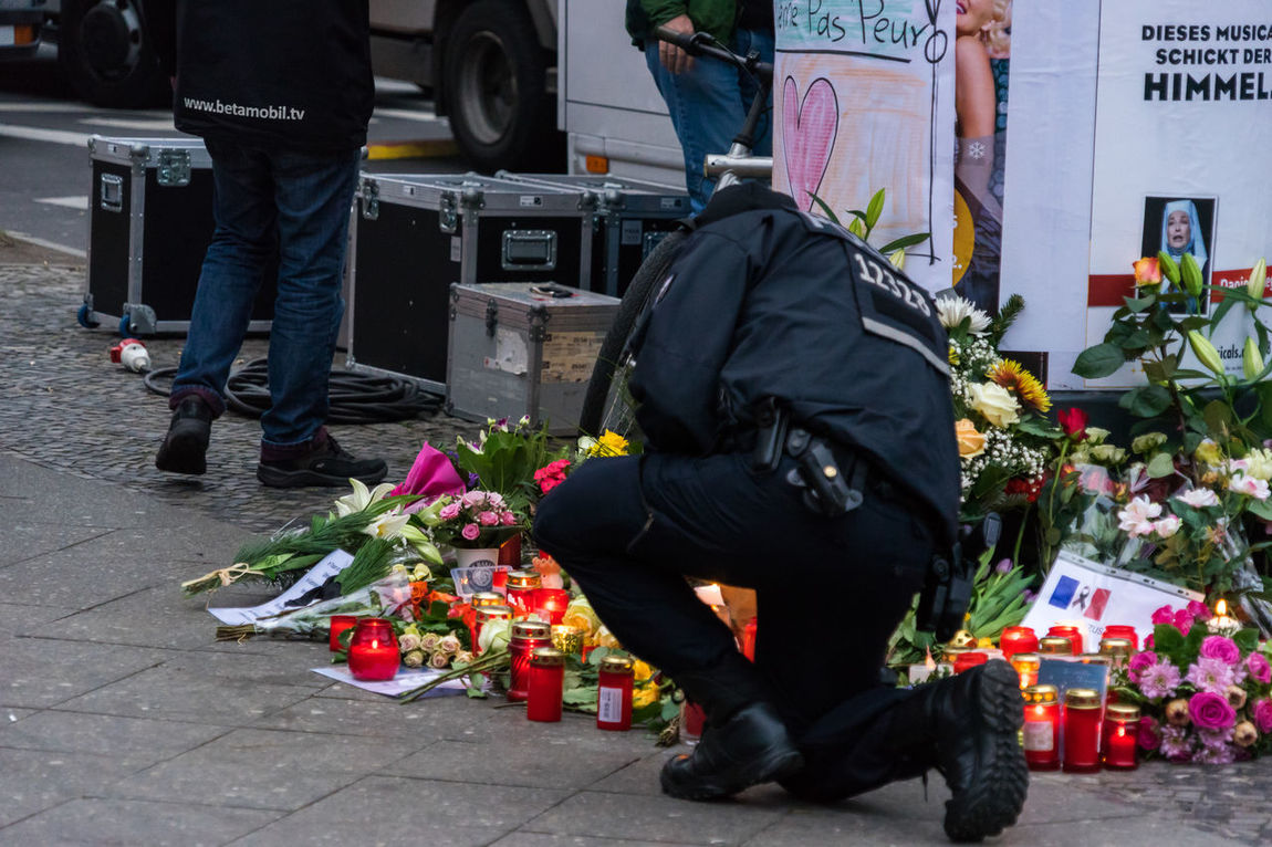 Breitscheidplatz in Berlin Charlottenburg the day after the terrorist attack Adult Berlin Charlottenburg  City Day Flower Investigation Law Low Section Media Men Mourning Outdoors People Police Press Terrorist Terrorist Attack