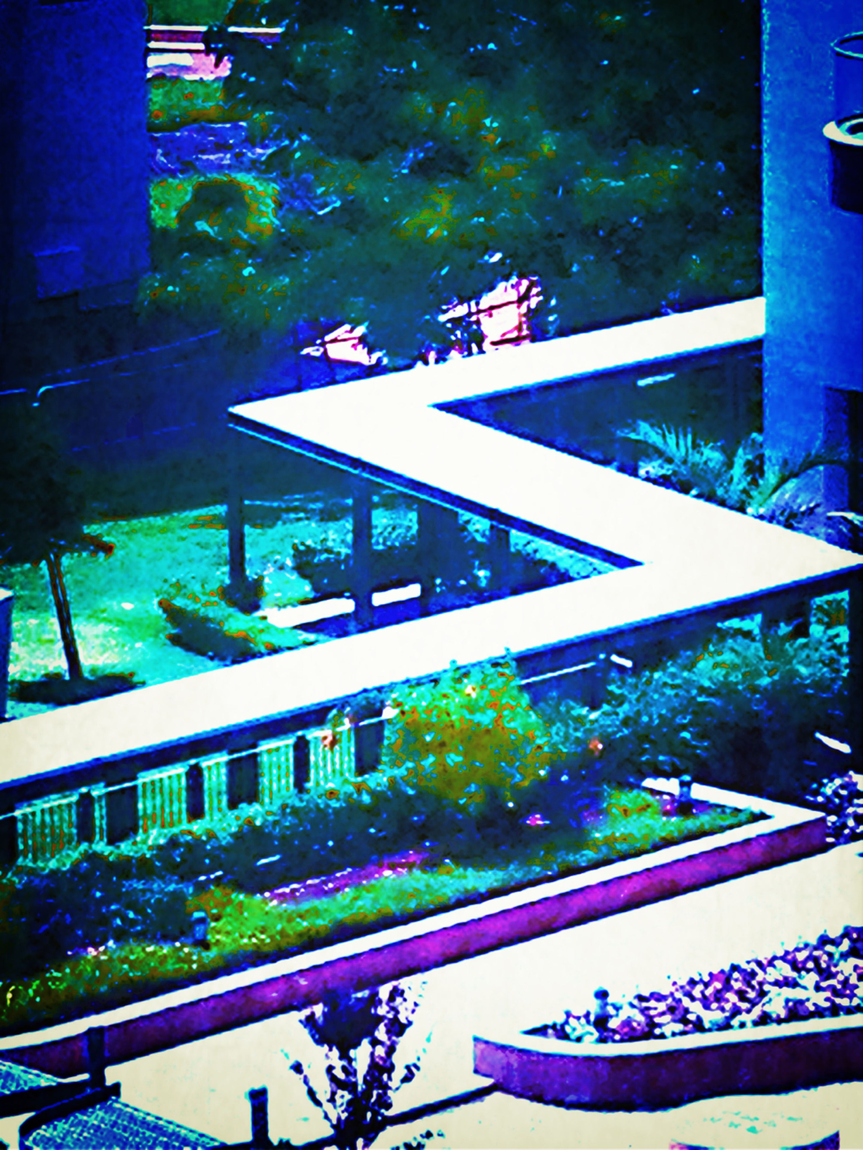 built structure, architecture, water, building exterior, swimming pool, high angle view, railing, reflection, city, tree, blue, pond, outdoors, day, park - man made space, sunlight, building, green color, no people, modern