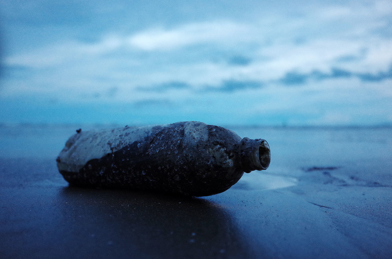 Bottle Close-up Day Nature No People Outdoors Sand Sea Trash Water Wet Wet Day