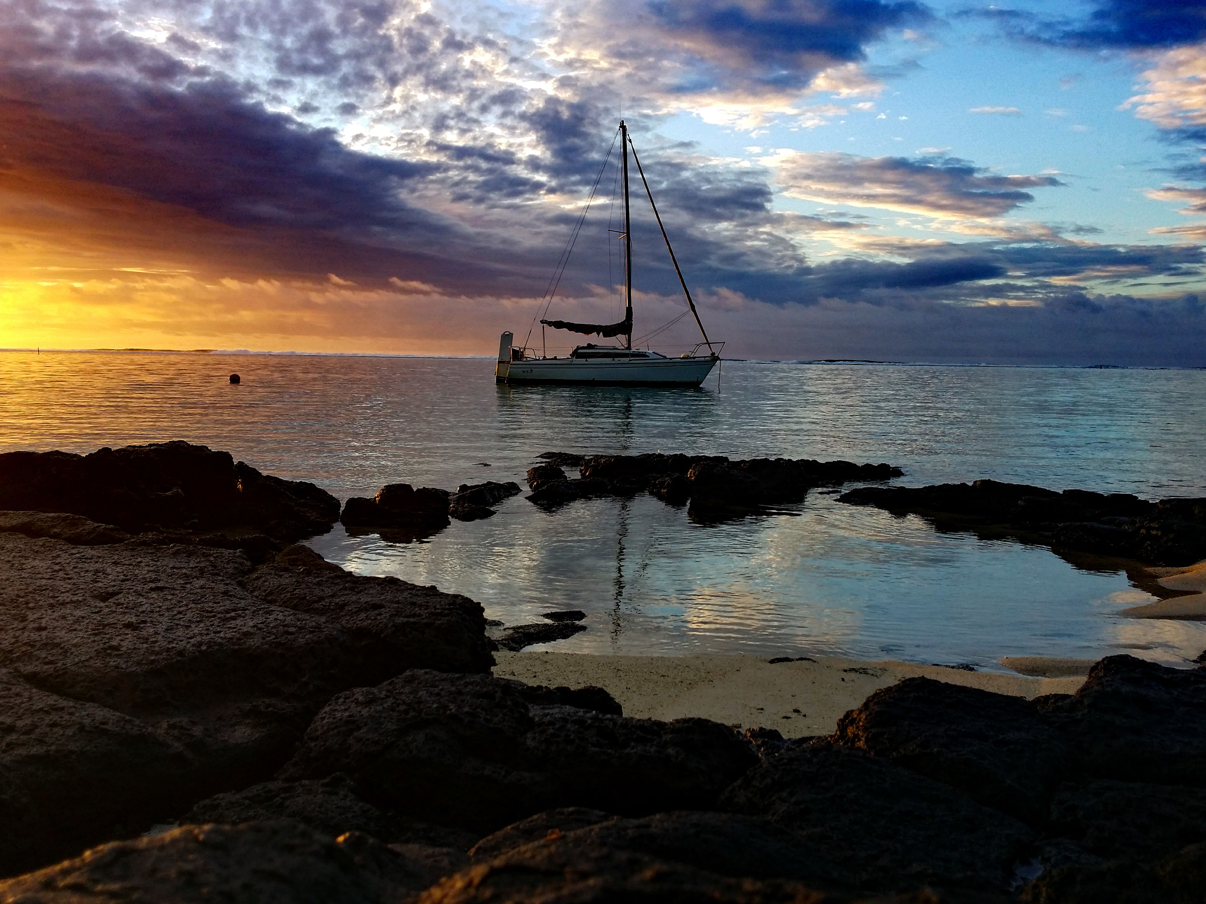 sea, water, nautical vessel, transportation, sky, boat, mode of transport, horizon over water, sunset, scenics, tranquility, cloud - sky, beauty in nature, tranquil scene, moored, nature, silhouette, cloud, mast, idyllic