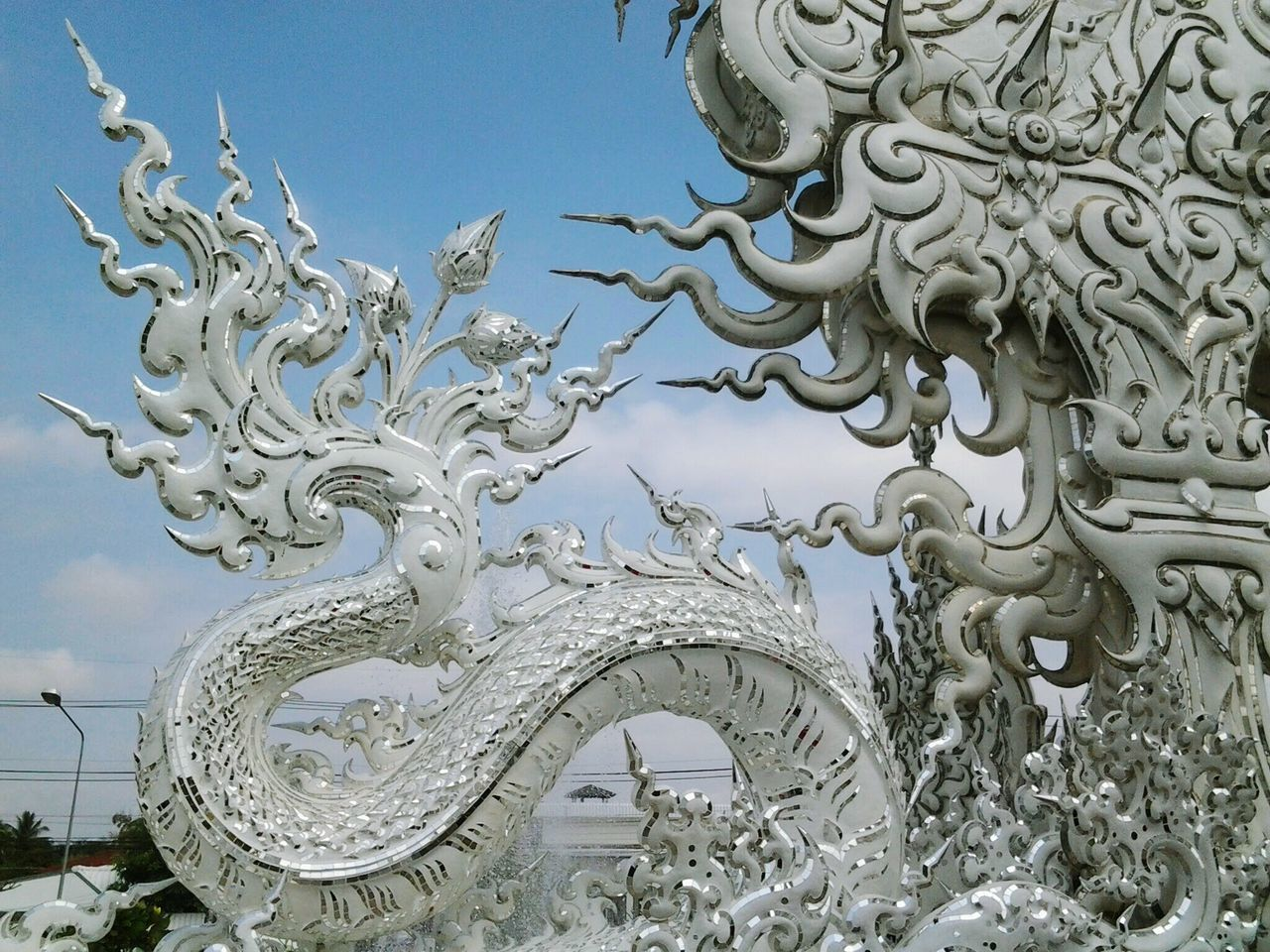 Naga in the imagination of Buddhist. Wat Rong Khun. Chiang Rai. TH. Focus On Foreground Sculpture Full Frame Thailand Temple Landscape Tradition Beauty Religion Spirituality Outdoors Buddhism Culture Buddhist Temple Luxury Illuminated Arts Culture And Entertainment Place Of Worship Travel Destinations Travelling Thailand BUDDHISM IS LOVE Ornate Low Angle View Architecture Scenics No People Statue