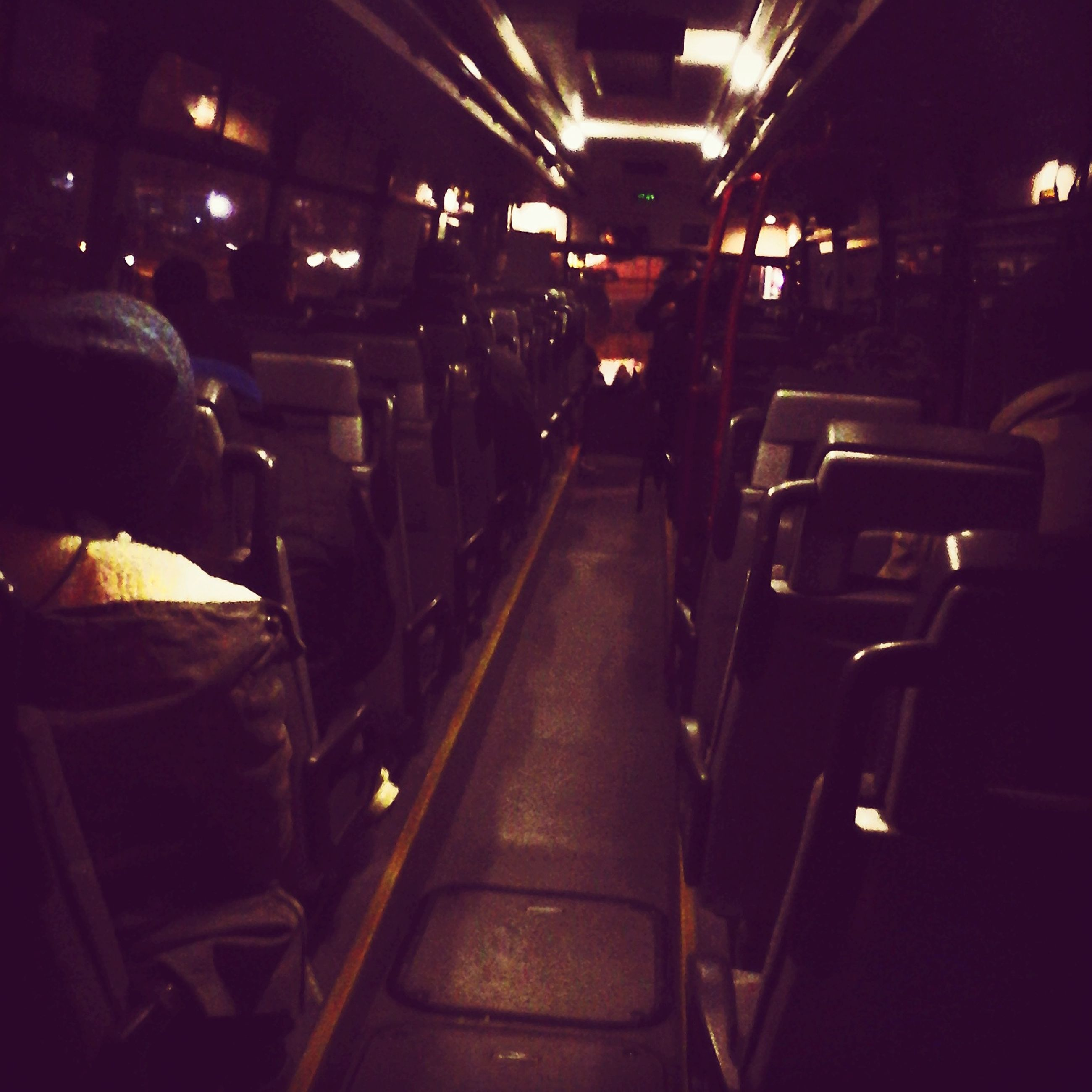 indoors, illuminated, transportation, night, men, mode of transport, incidental people, vehicle interior, vehicle seat, public transportation, travel, lifestyles, land vehicle, sitting, bus, person, rear view, unrecognizable person