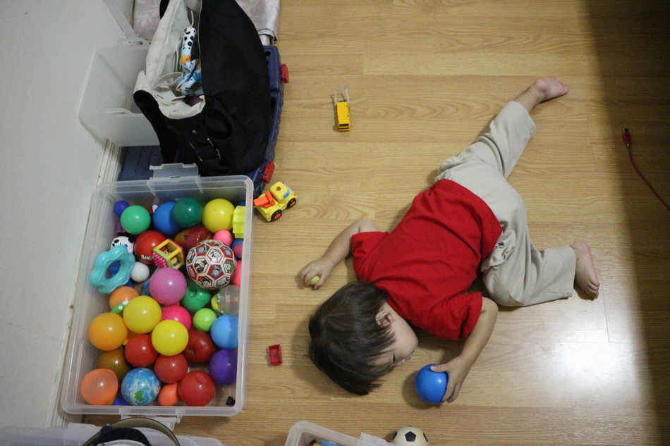 Ball Boy Child Crawling Day High Angle View Human Body Part Indoors  Kid Learning Male Multi Colored One Boy One Person People Play Sleep Toy Variation