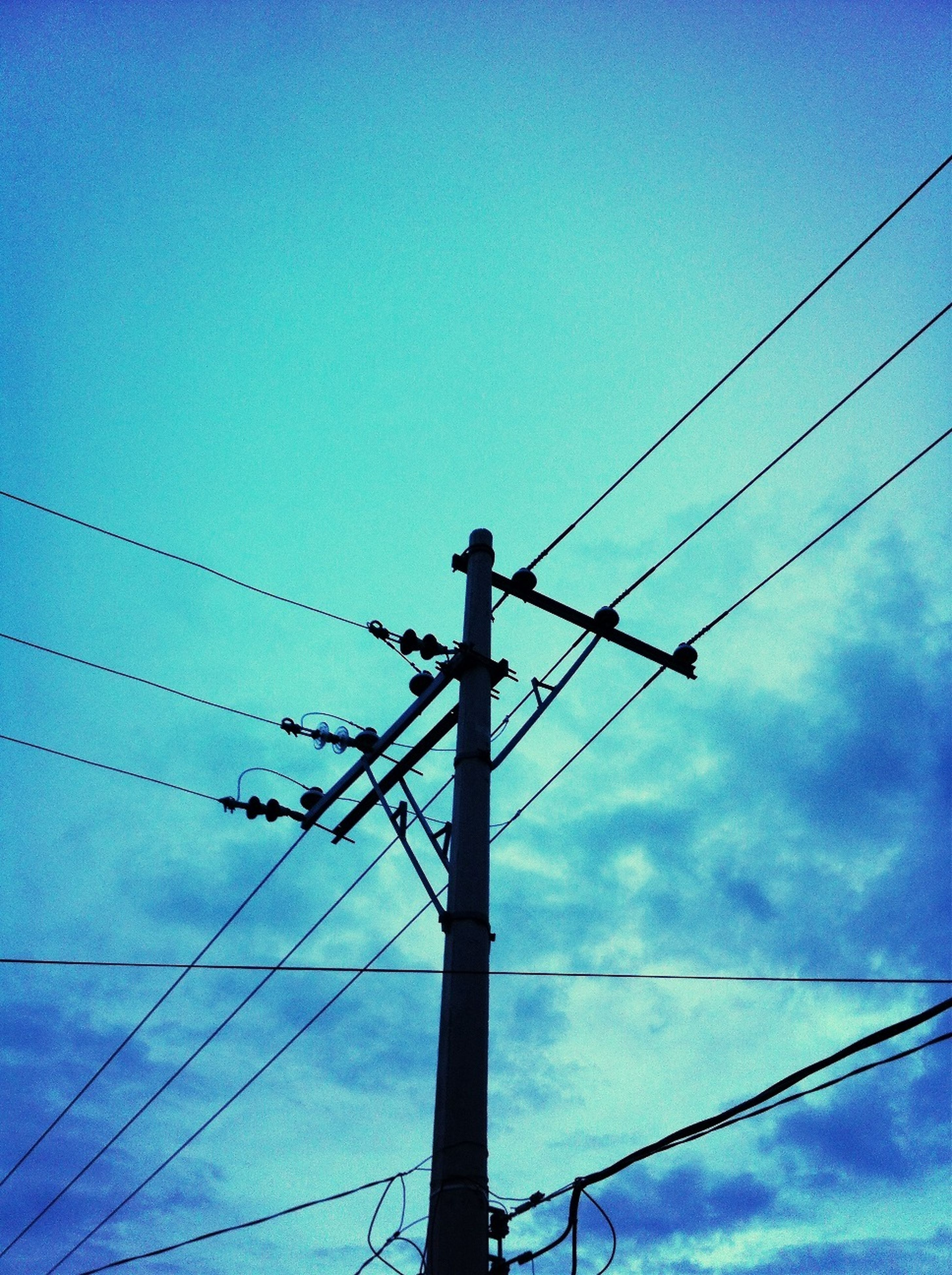power line, power supply, electricity, low angle view, electricity pylon, connection, cable, fuel and power generation, technology, sky, silhouette, blue, power cable, electricity tower, dusk, outdoors, pole, complexity, no people, telephone pole