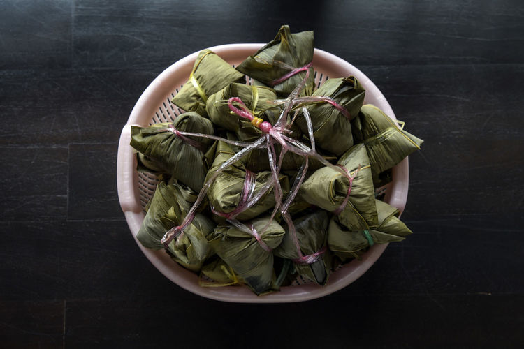 Bak Zhang aka glutinous rice dumplings Bak Zhang Chinese Festival Close-up Day Dragon Boat Festival Duanwu Dumplings Food Food And Drink Freshness Glutinous Rice Green Color Indoors  No People Table Zhang