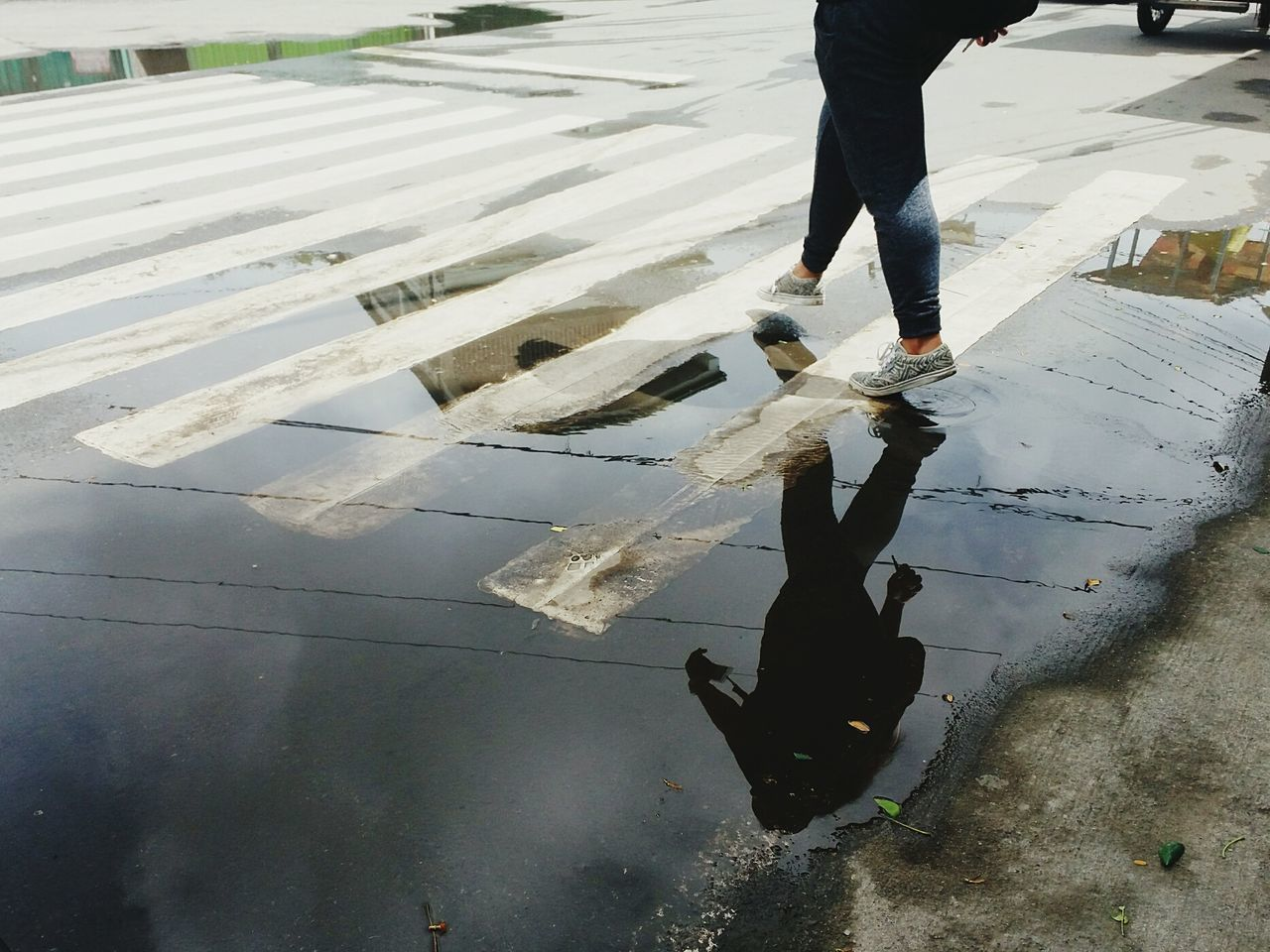 It's like I'm a mirror.. Low Section Person Walking Lifestyles Road Reflection Standing Shadow Human Foot Sunlight EyeEm Eyeem Philippines Feet Shoes Reflection Footwear Footpath FilipinaStreet Unrecognizable Person Puddle Footpath Water Outdoors Philippines