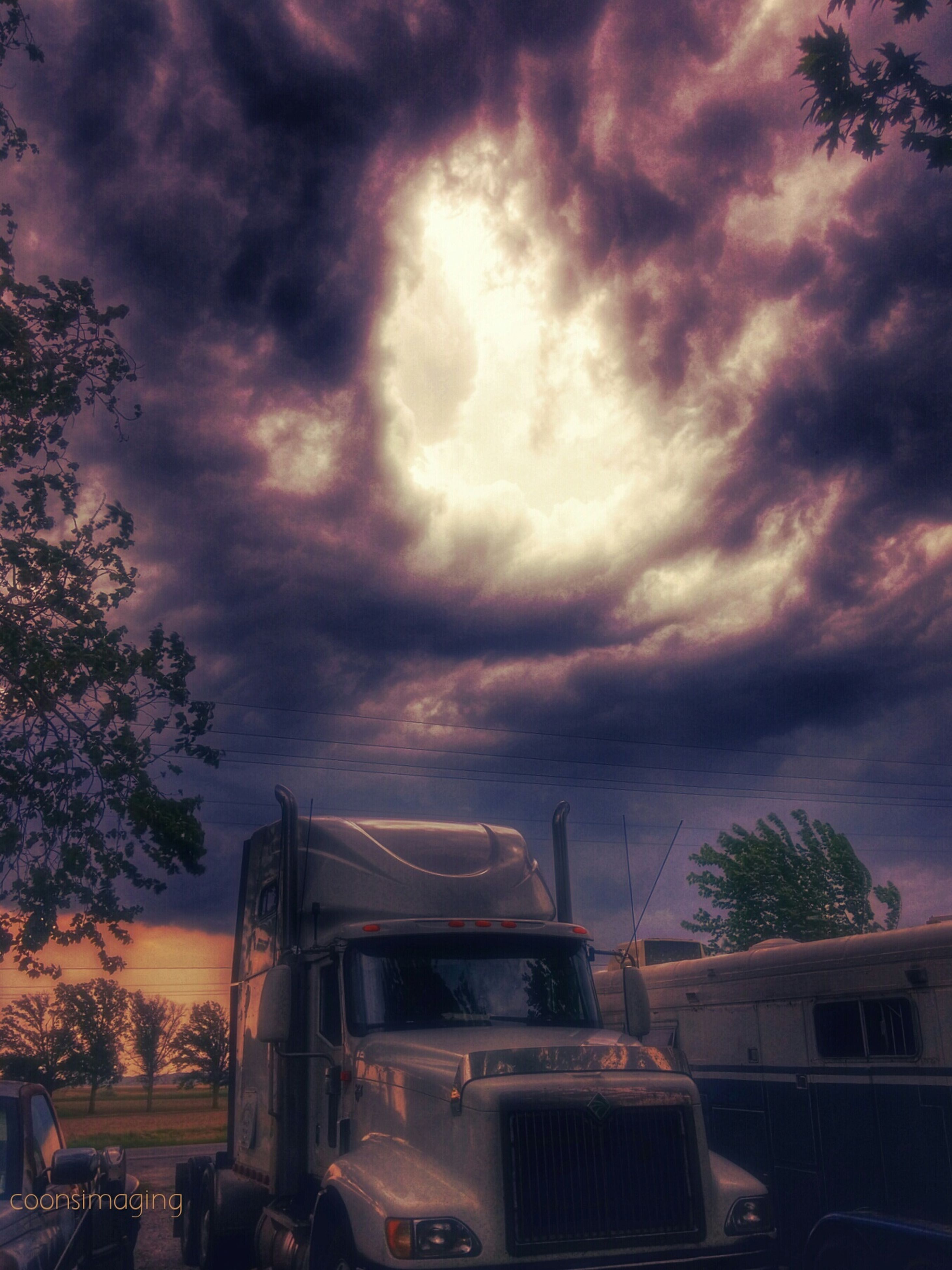 sky, cloud - sky, cloudy, land vehicle, car, transportation, weather, storm cloud, building exterior, mode of transport, overcast, sunset, built structure, architecture, dramatic sky, tree, dusk, cloud, atmospheric mood, house