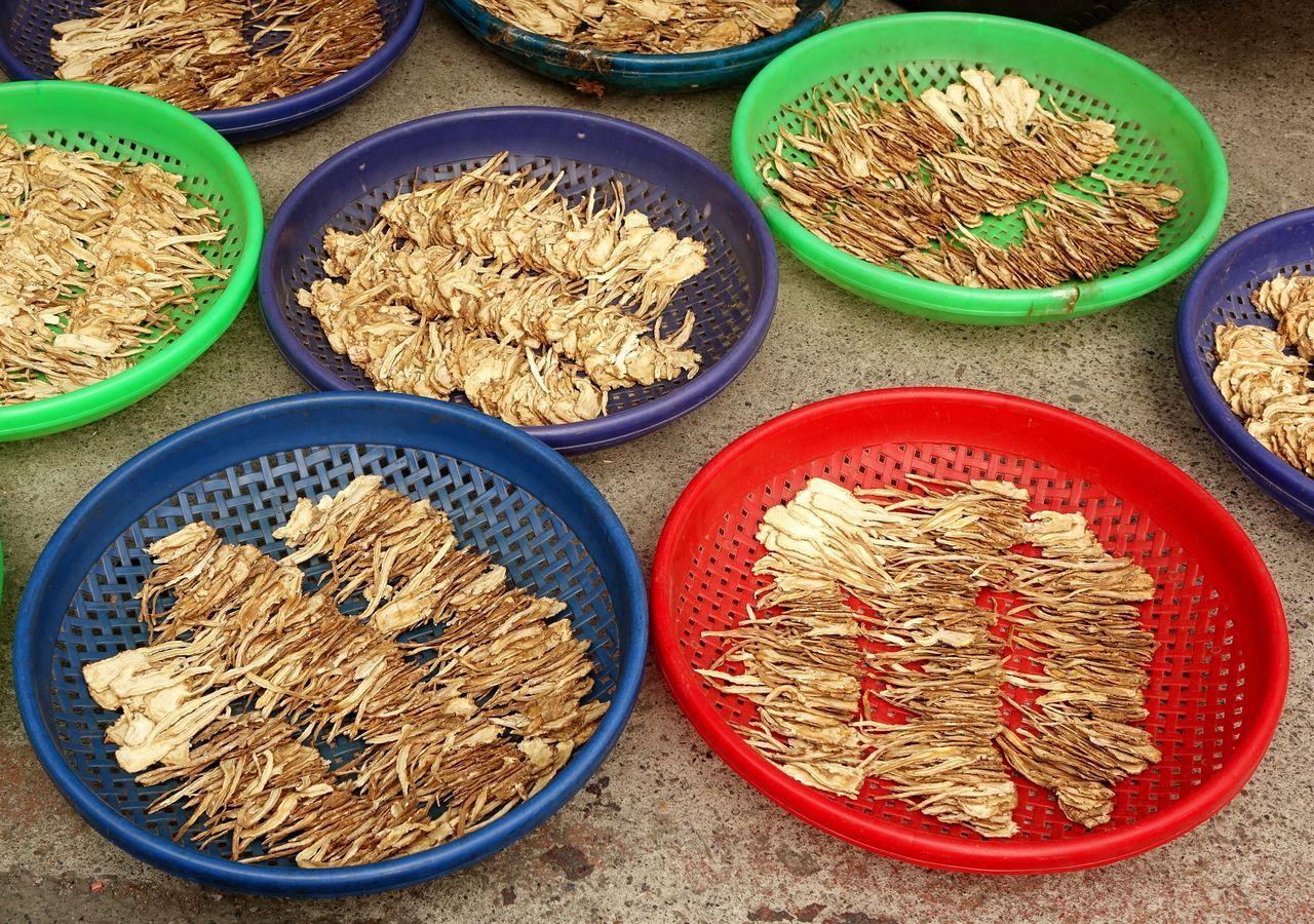 A market vendor sells Chinese medicinal dried herbs Chinese Medicine Dried Herbs Ginseng Herbal Medicine Herbs Market Stall Market Vendor Medicinal Plant Taiwan