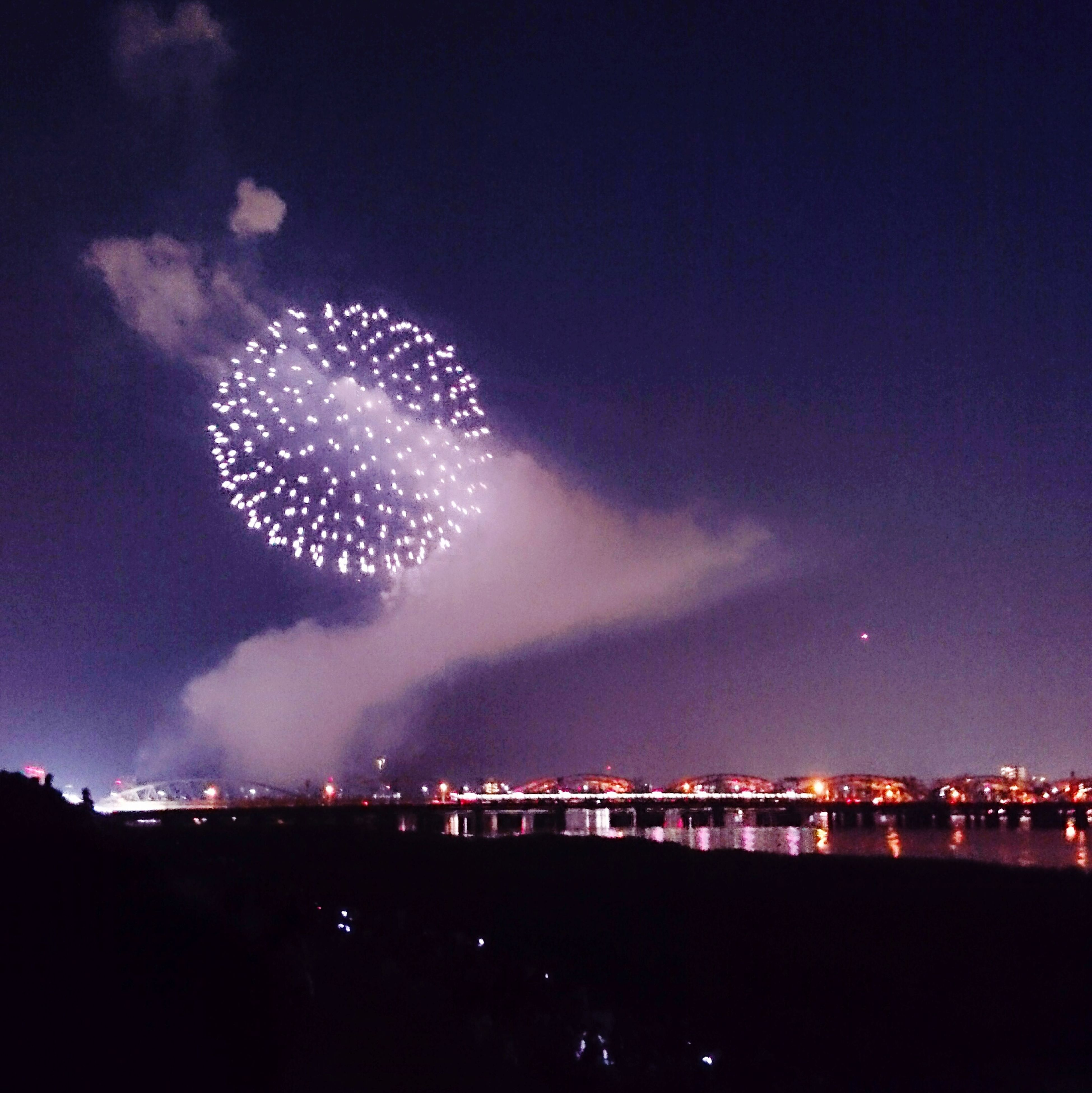night, illuminated, sky, long exposure, firework display, exploding, glowing, building exterior, motion, firework - man made object, celebration, arts culture and entertainment, city, built structure, architecture, scenics, outdoors, light, water, light - natural phenomenon