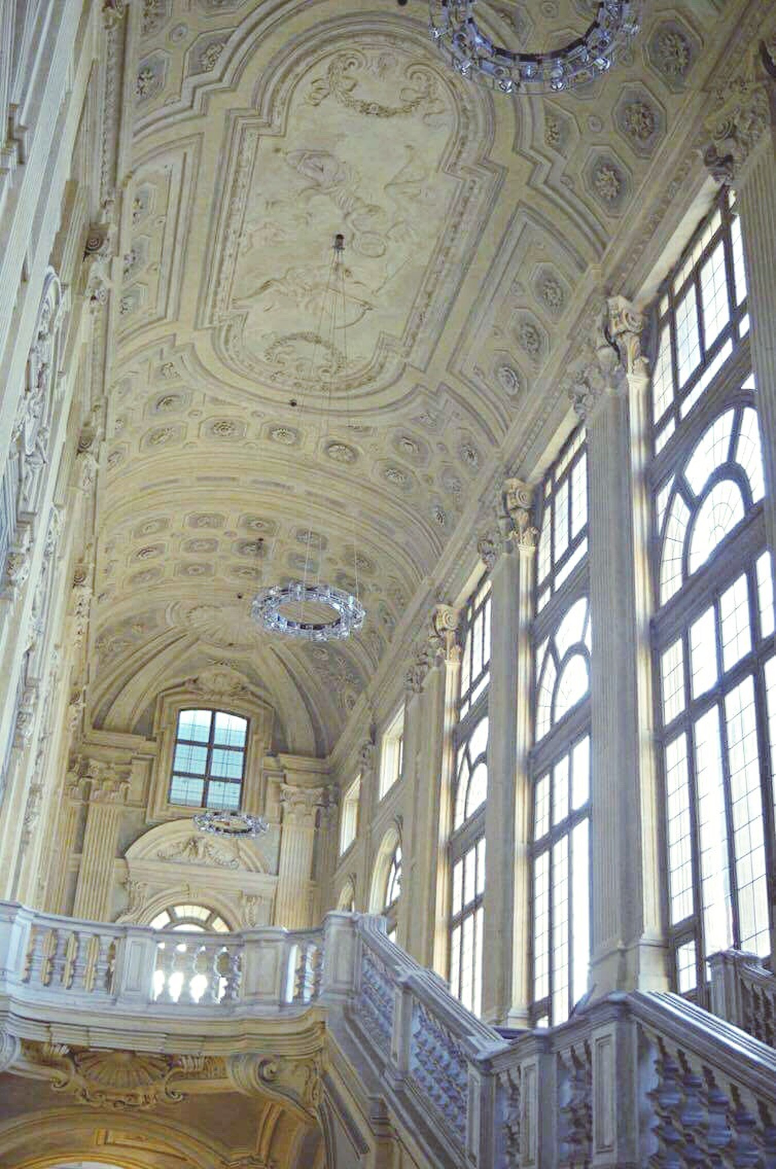 ceiling, indoors, low angle view, window, architecture, built structure, architectural column, history, day, no people