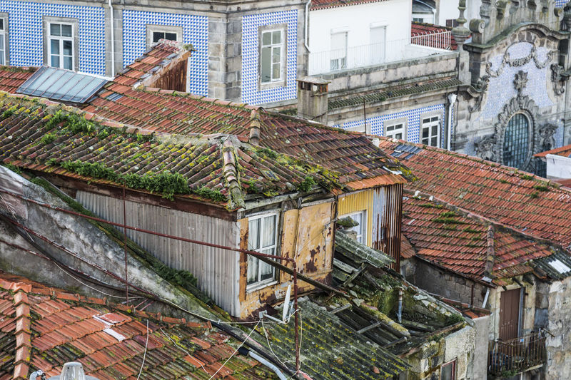 A lot of abonded buildings in the city of Porto Abonded Buildings Brick Wall Building Exterior Built Structure House Old Residential Structure Roof Roof Tile