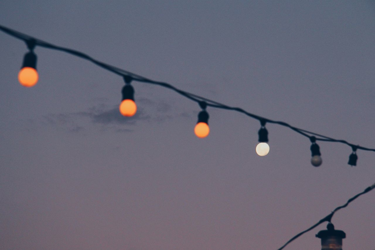 Moonbulb Adapted To The City Conceptual Creative Dawn Day Dusk Hanging Lightbulb Moon Moonlight Night No People Orange Outdoors Sky