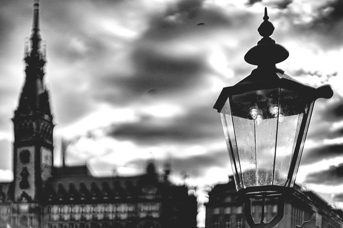 Street lamp in front of the townhouse Dramatic Sky Historical Building Bokeh Photography Black And White Townhouse Street Light Street Lamp Focus On Foreground No People Built Structure Architecture Hanging Celebration Building Exterior Outdoors Close-up Day Sky