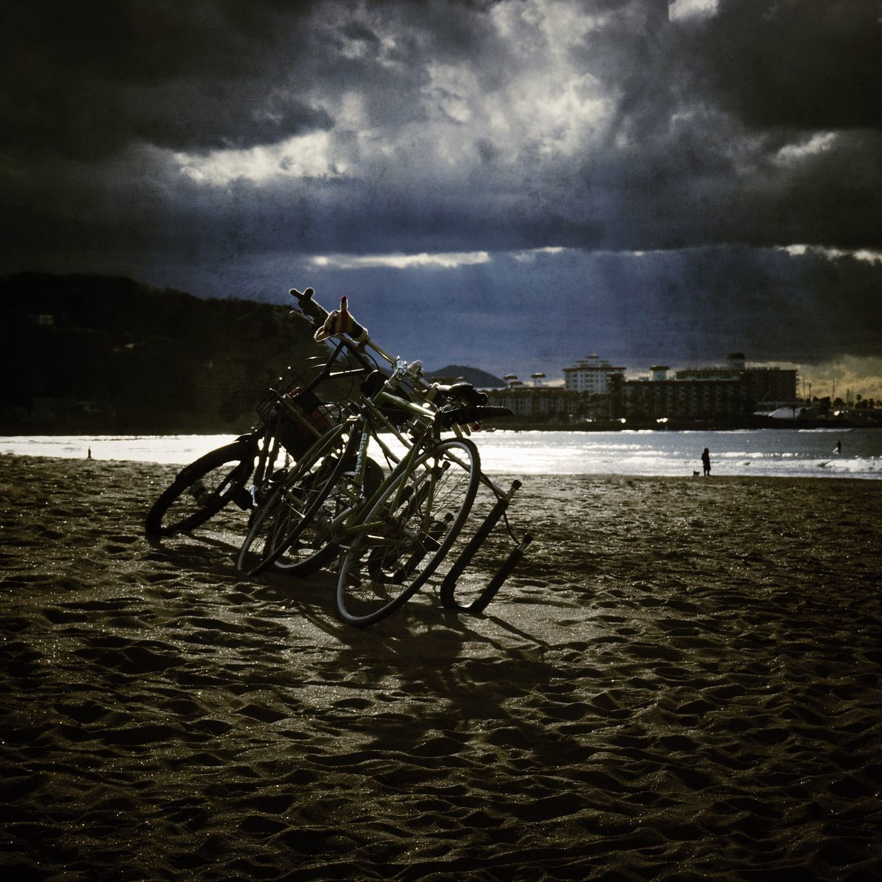 sky, cloud - sky, water, sea, beach, dusk, sand, bicycle, storm cloud, outdoors, no people, transportation, nature, day, horizon over water