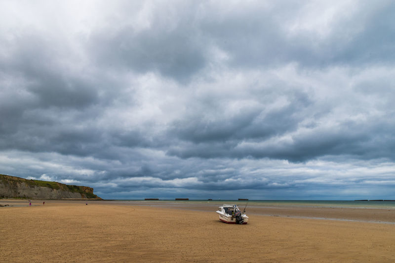 Photo taken in Arromanches, Normandy. Arromanches Beauty In Nature Boat Clouds Dramatic Sky France Normandie Normandy Ocean Sand Sea Seaside Sky Stranded Stranded Boat